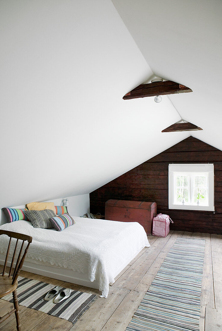 Simple bedroom in country-house style in attic room