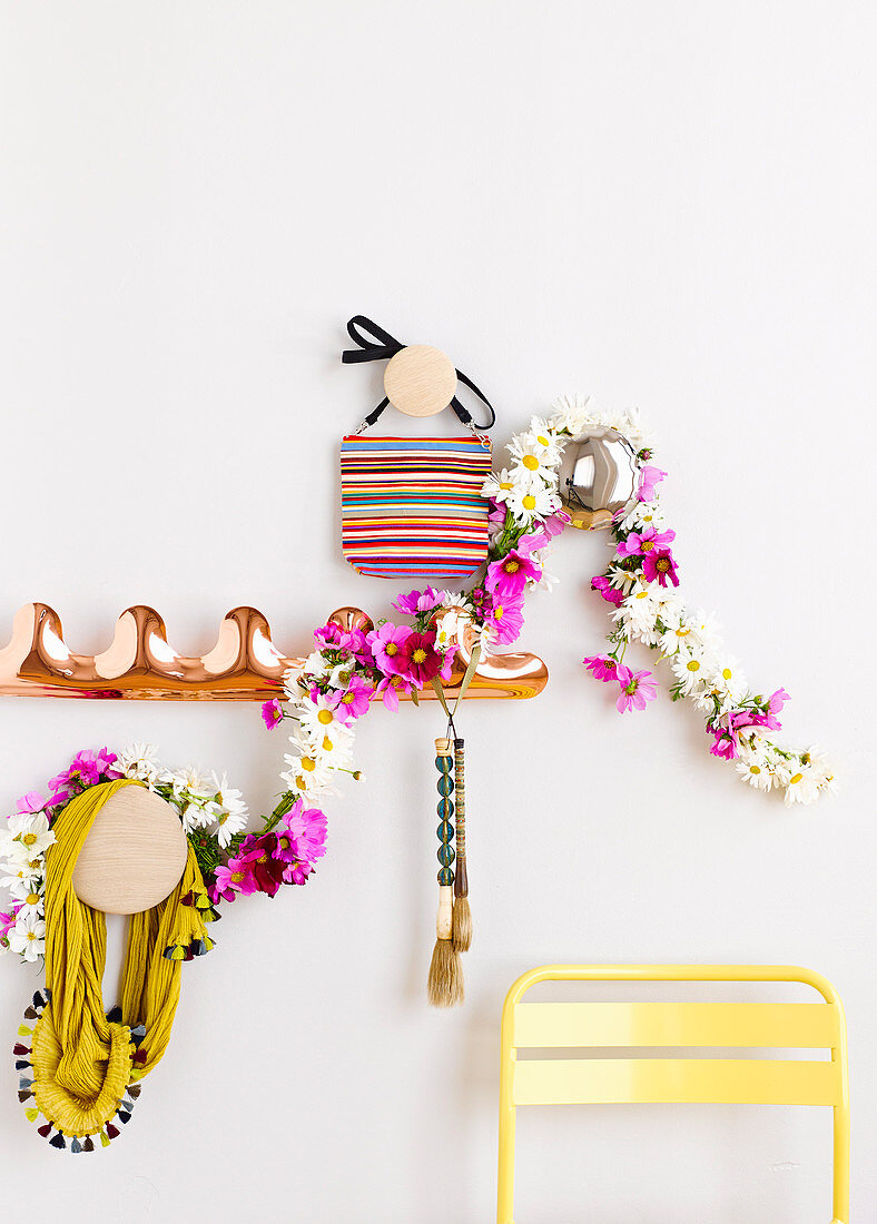 Garland of white and pink flowers on the wardrobe