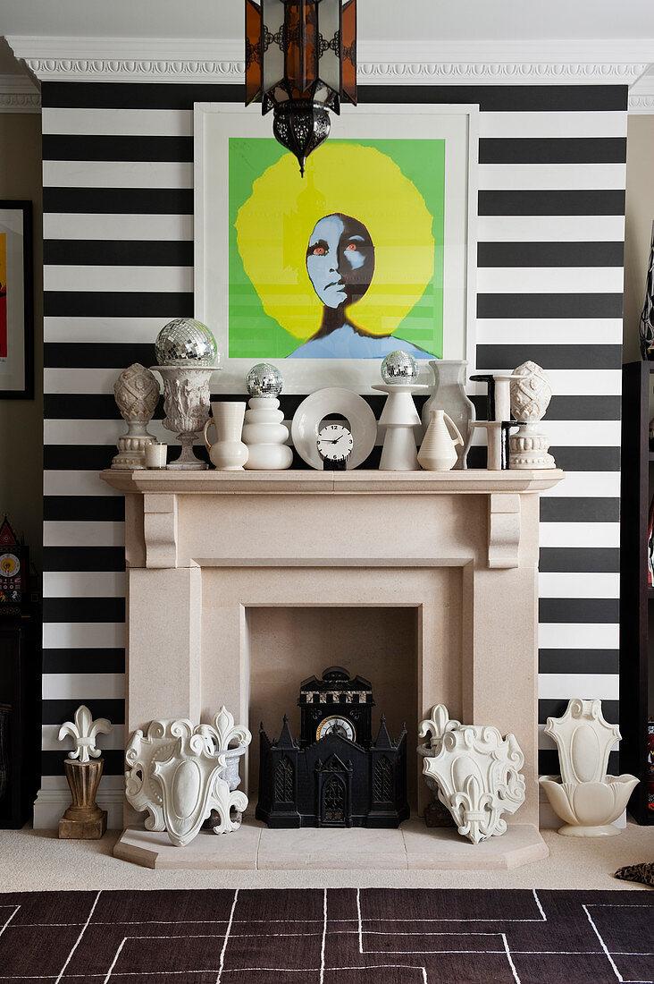 Eclectic collection of vases on mantelpiece below pop-art portrait of Marsha Hunt
