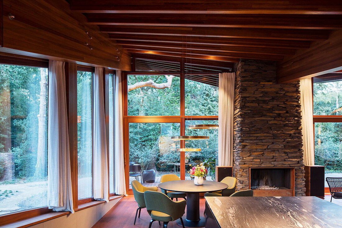 Open-plan kitchen-dining area in sustainable, architect-designed house