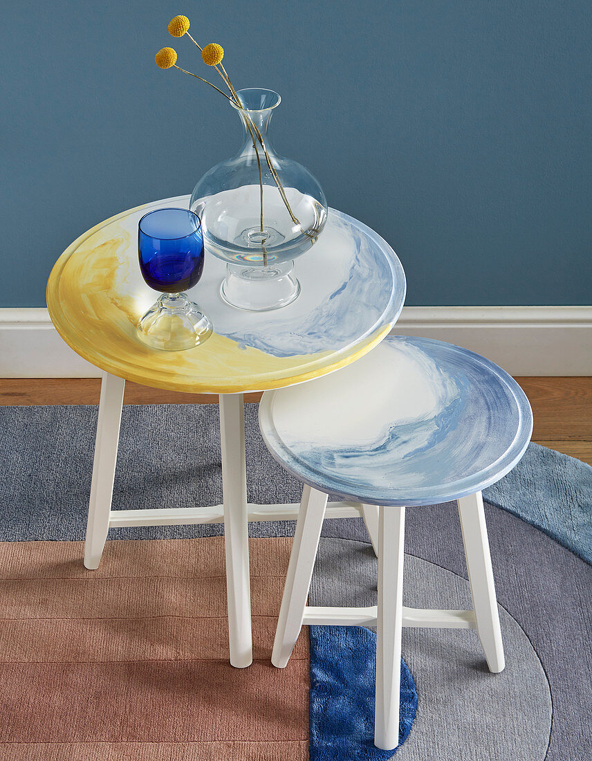 Two round side tables with hand-painted watercolour-effect tops