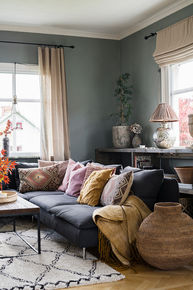 Ethnic scatter cushions in living room with grey walls