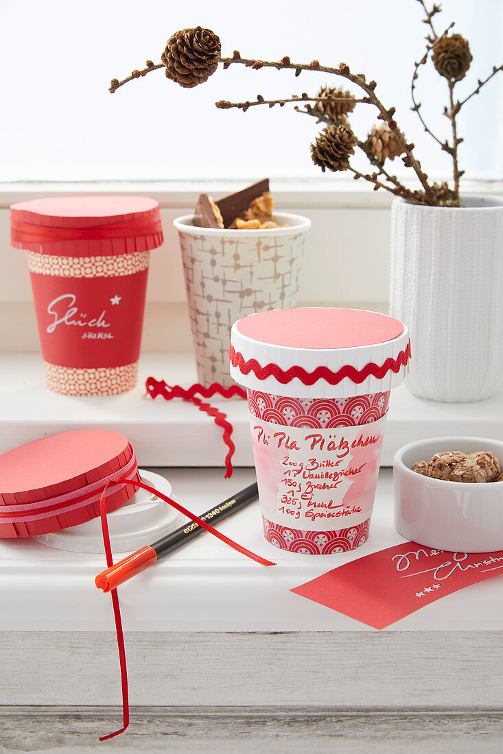 Hand-decorated beakers for sweets