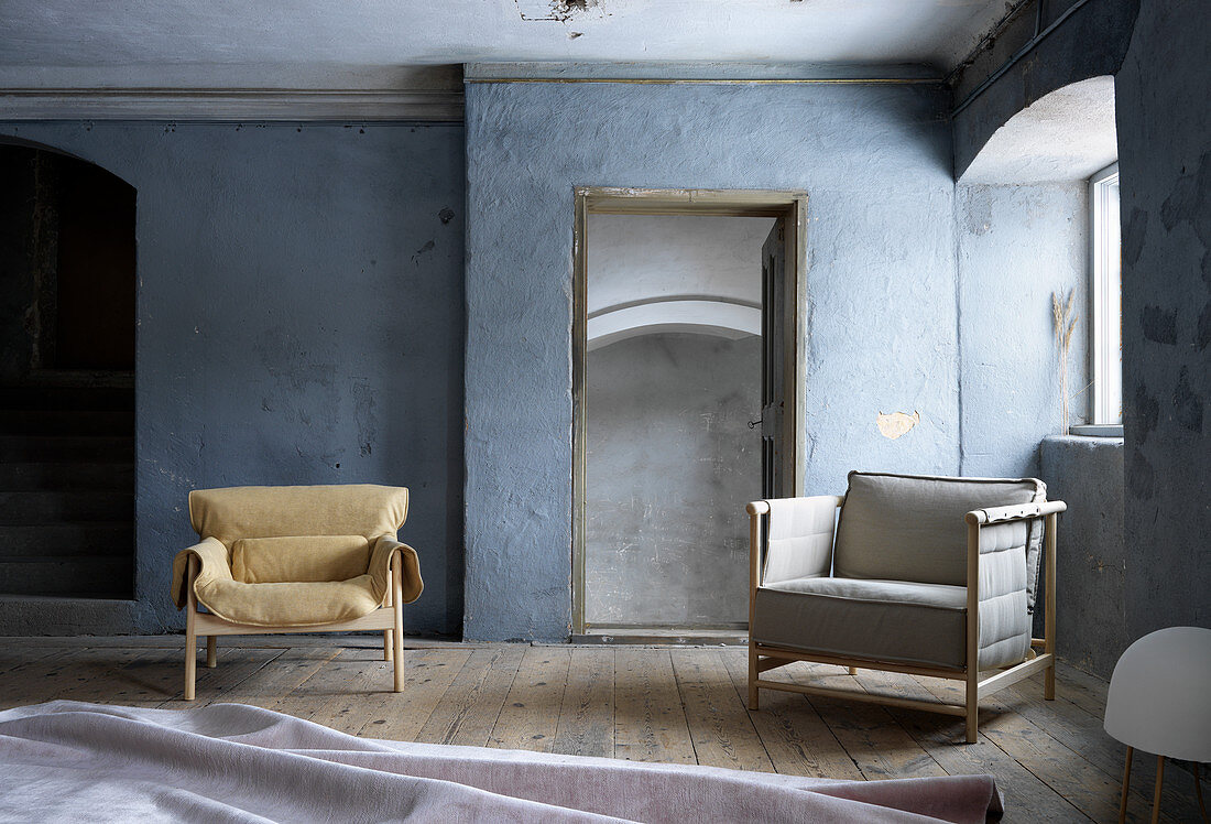 Seating in blue-grey room with wooden floor