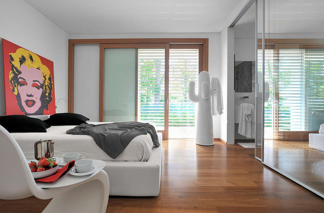 Modern bedroom with garden access and ensuite bathroom