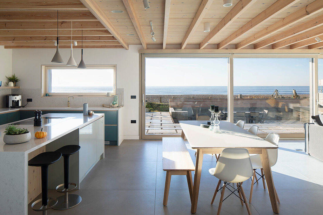 Modern, open-plan interior with sea view