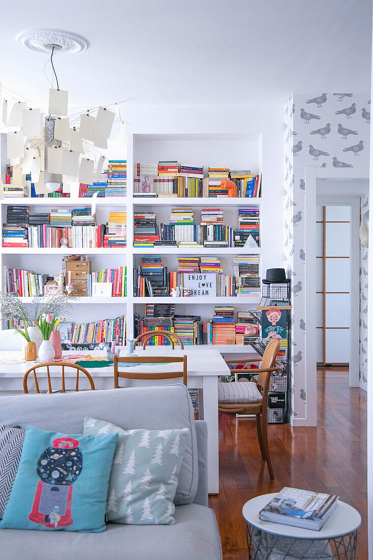 View past sofa and dining table to bookshelves