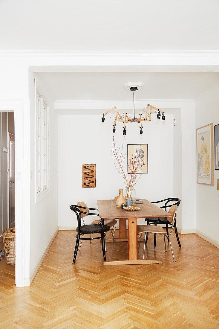 Herringbone parquet floor and vintage furniture in simple dining room
