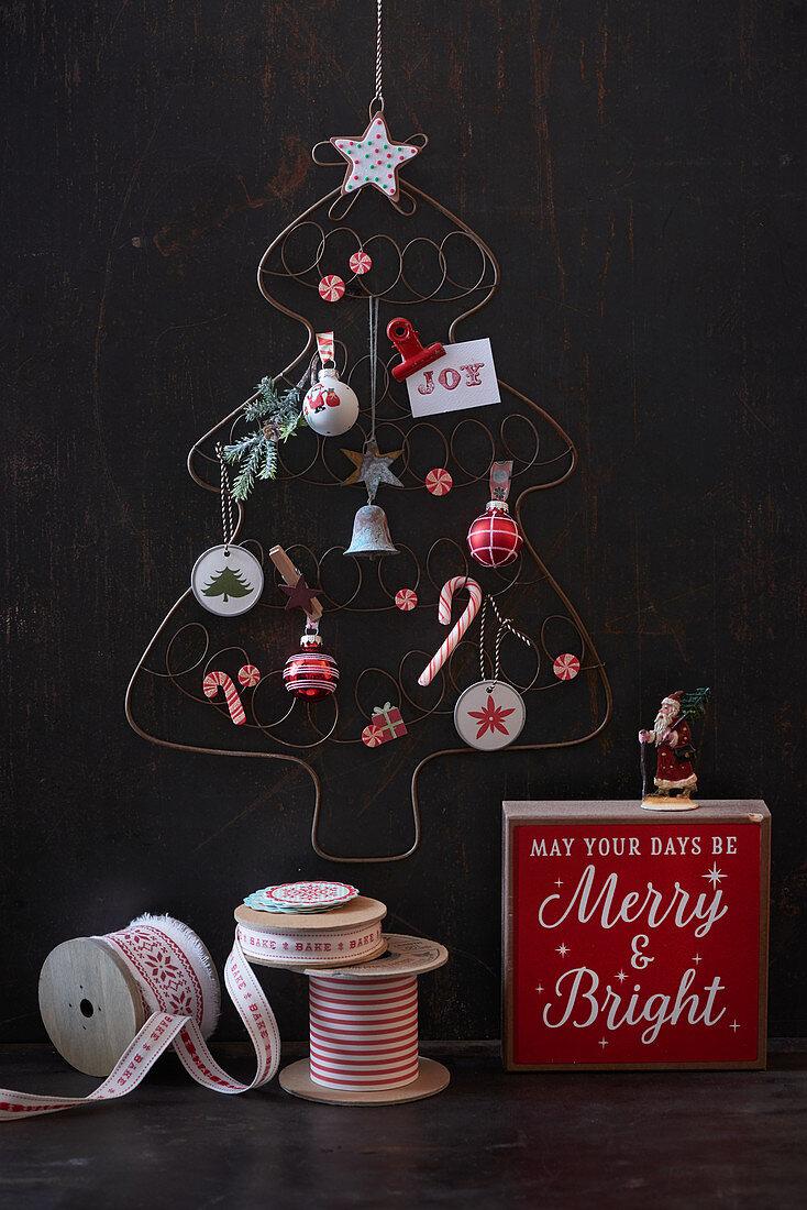 Stylised wire Christmas tree on dark wall