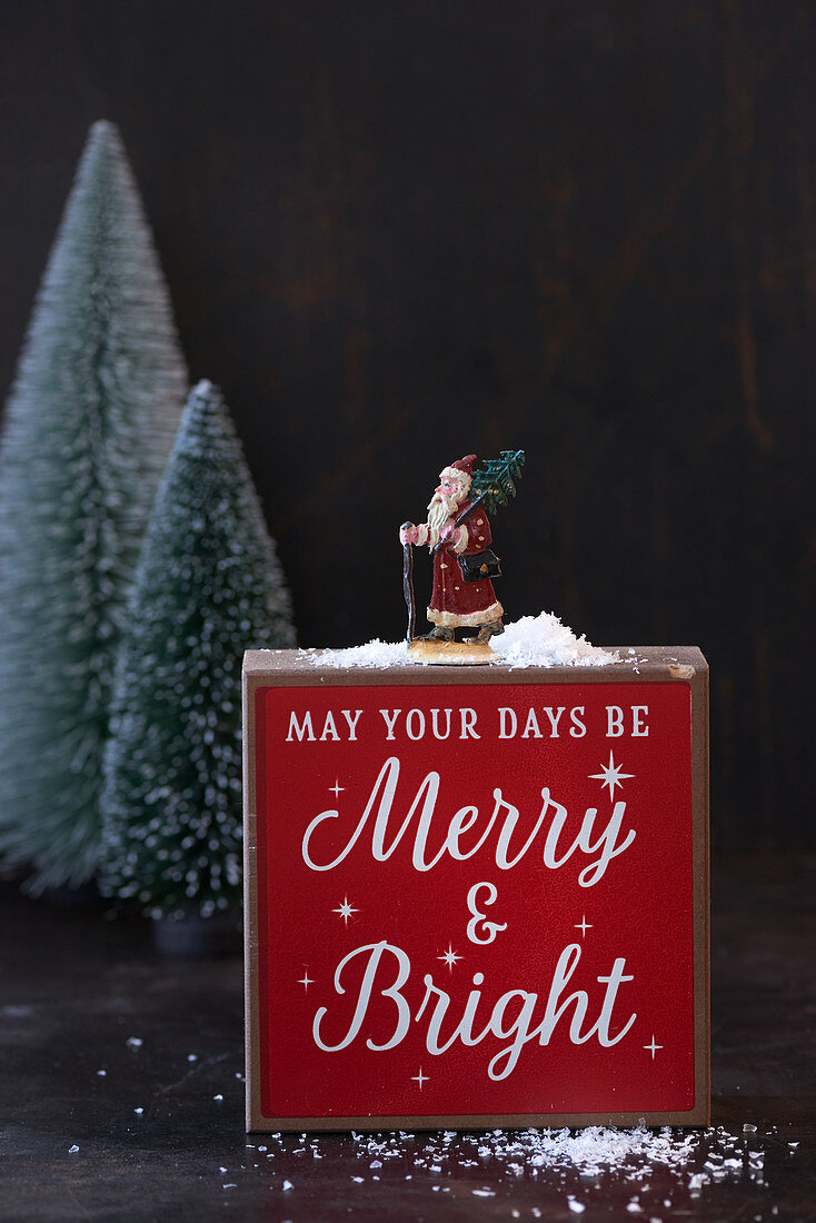 Father Christmas figurine and festive greeting
