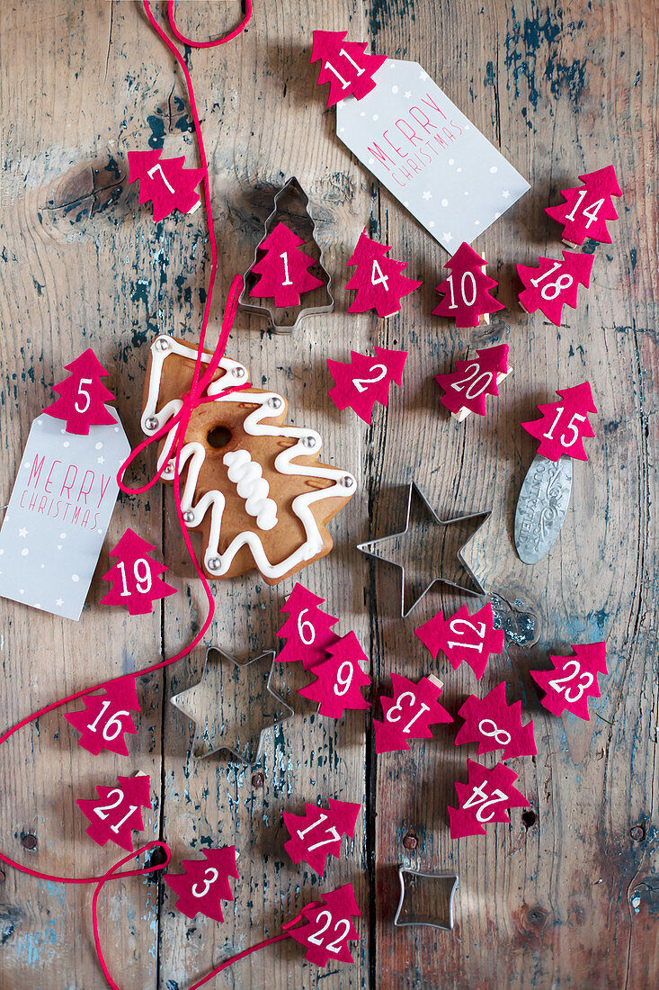Numbered Christmas trees made from red felt and pastry cutters