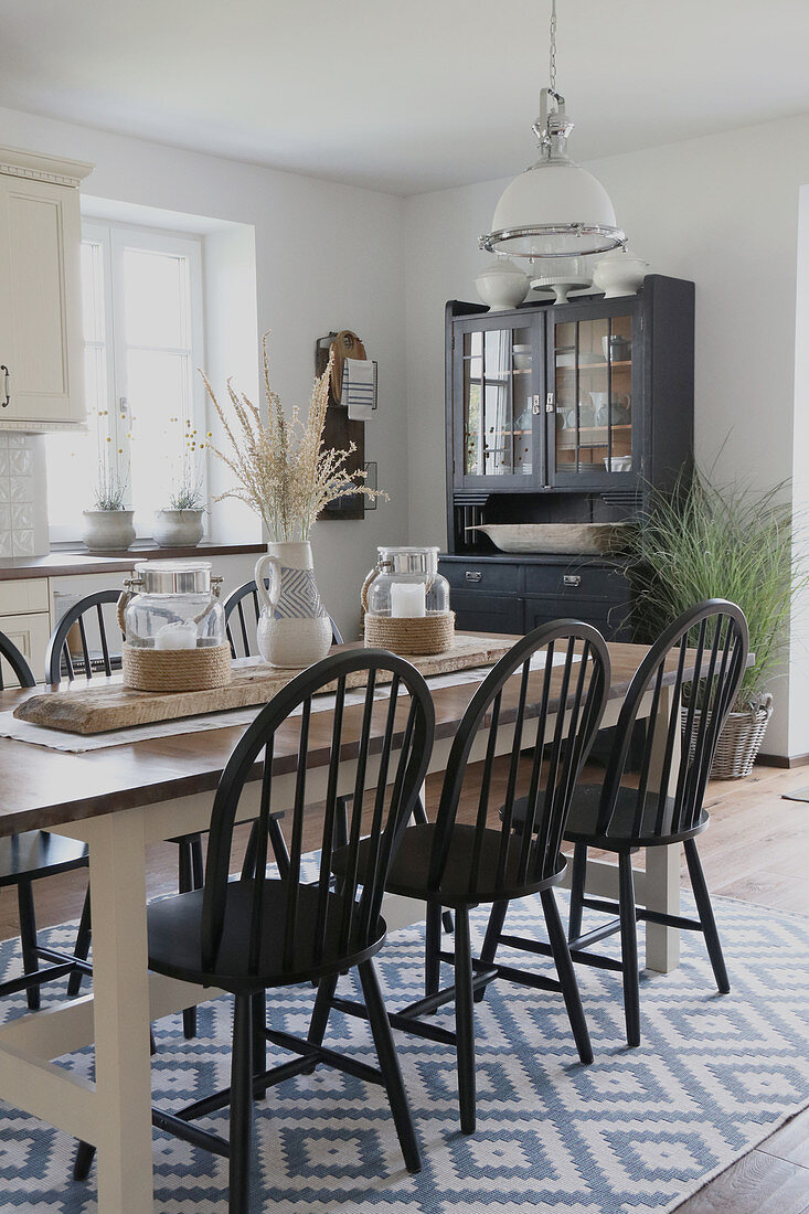 Dining area in modern country style with summery decorations
