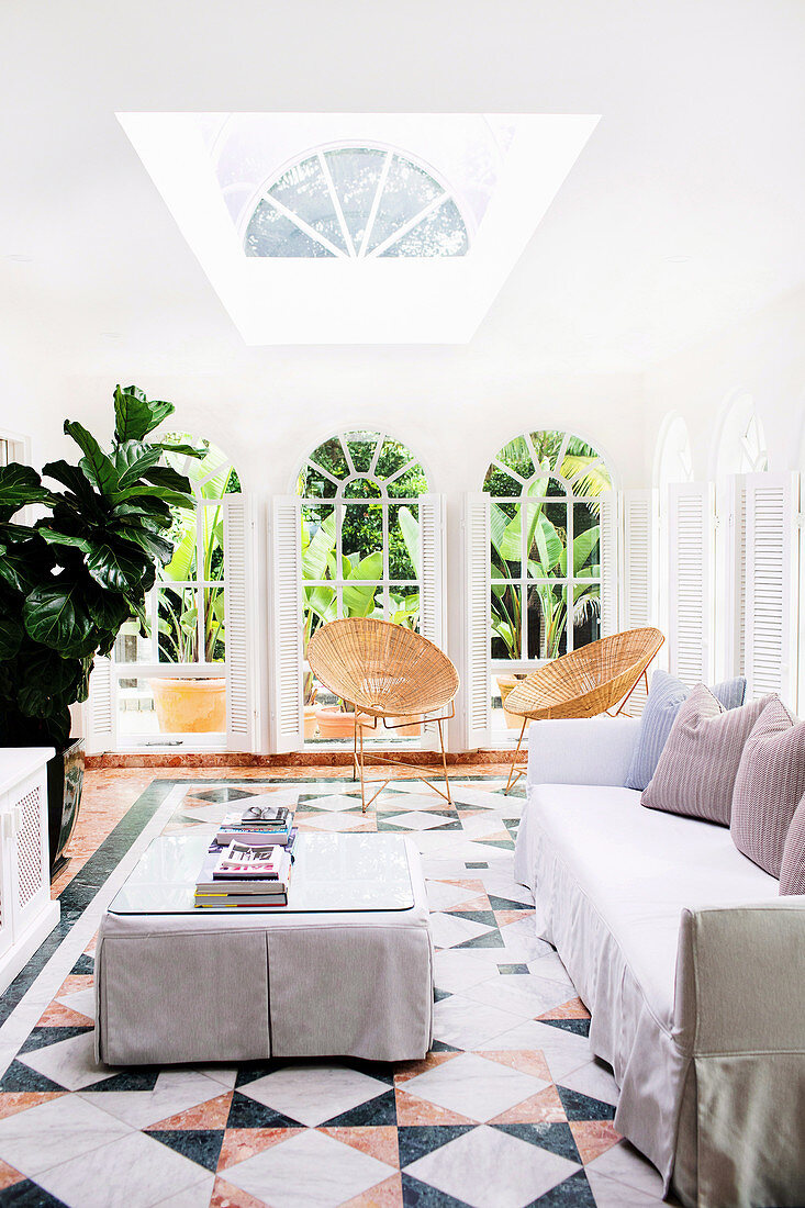 Lounge with slipcover furniture, tiled floors and French doors, Byron Bay, New South Wales, Australia
