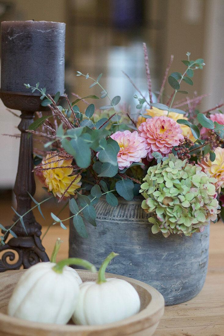Autumn arrangement with hydrangea, dahlias, and eucalyptus, 'Baby Boo' pumpkin