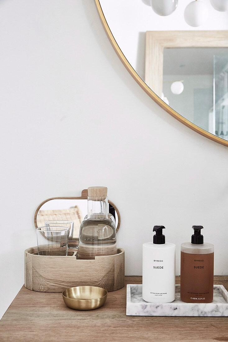 Bath accessories on wooden shelf