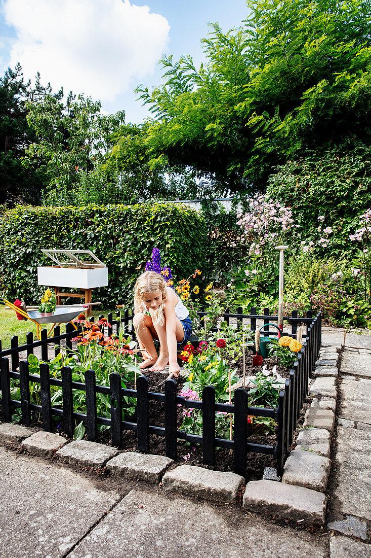 Girls in the fenced mini-garden