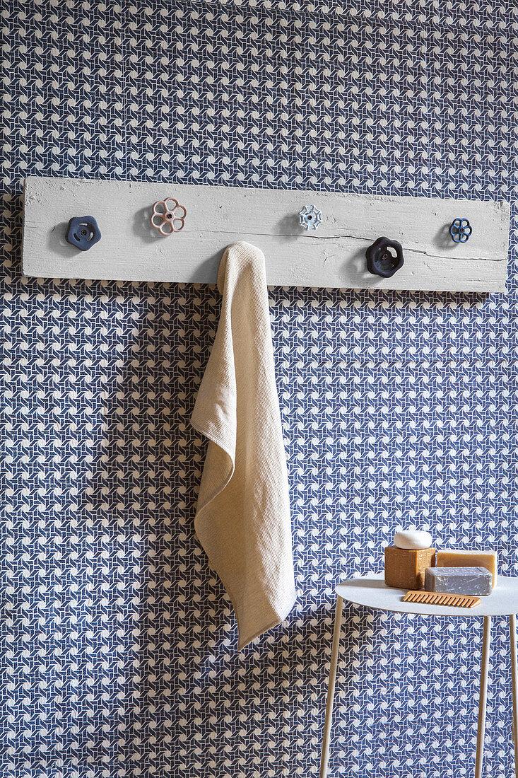Handmade coat rack with industrial valve handles as hooks in bathroom