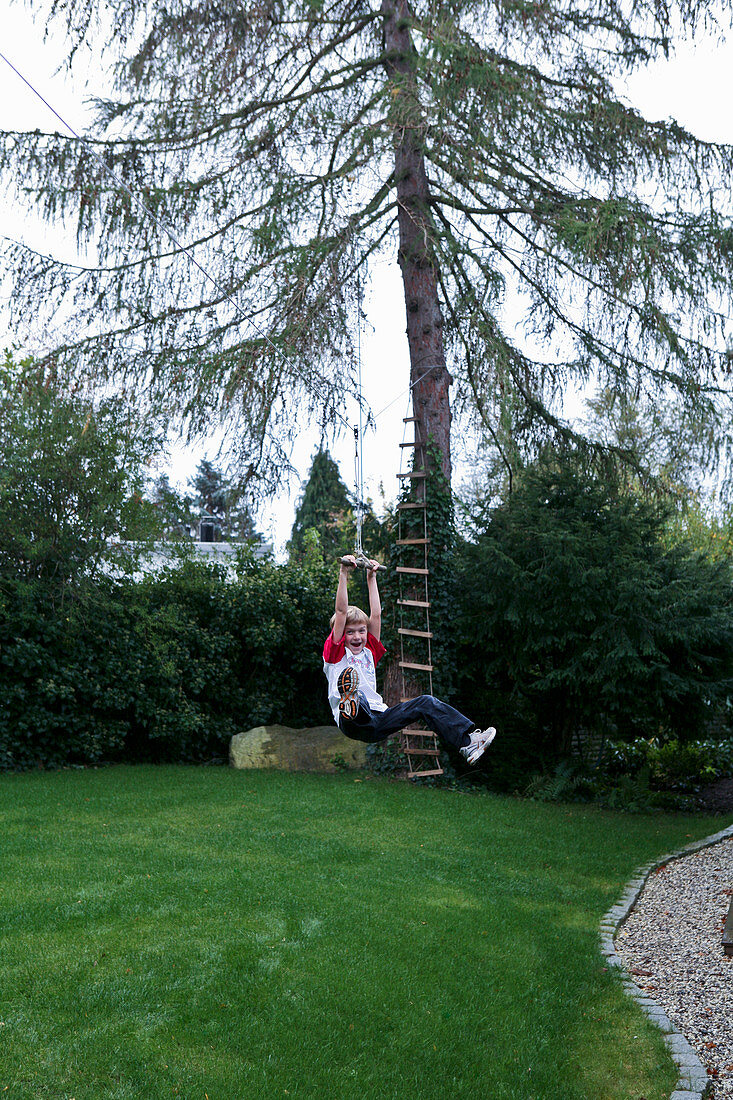 Boy sliding down zipline