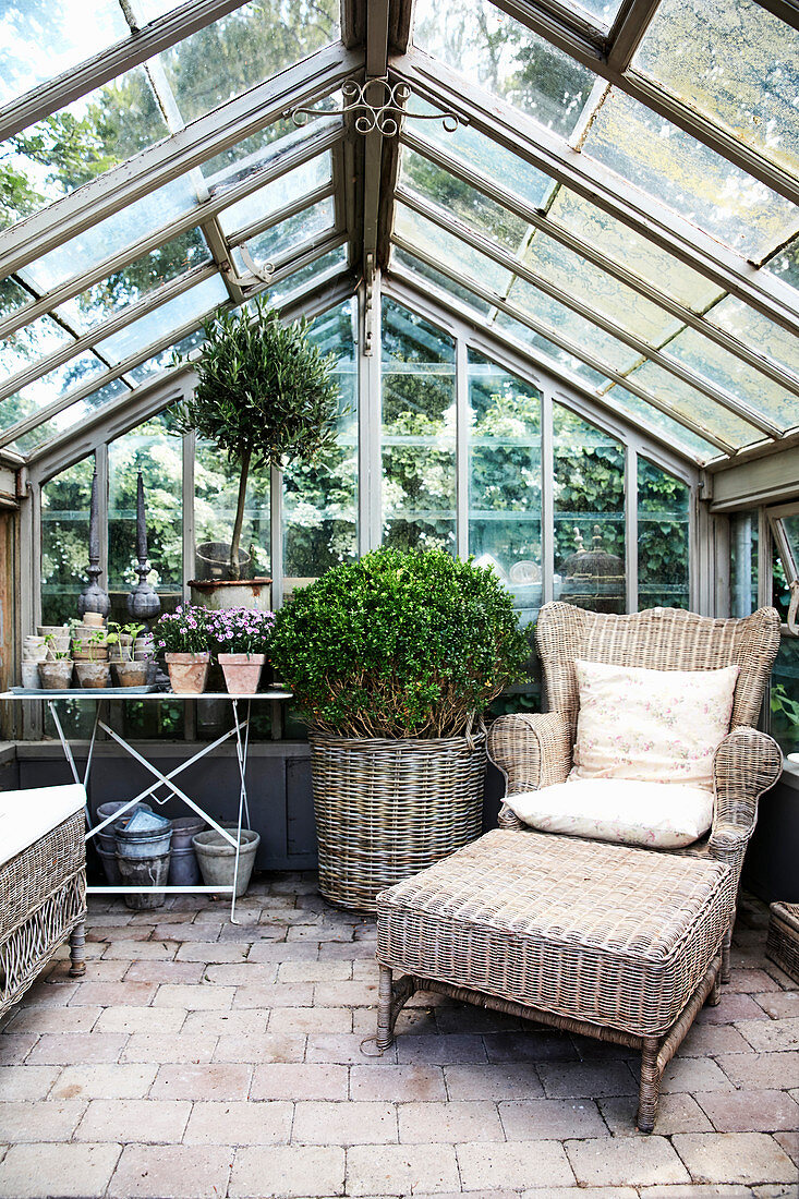 Comfortable seating area in greenhouse