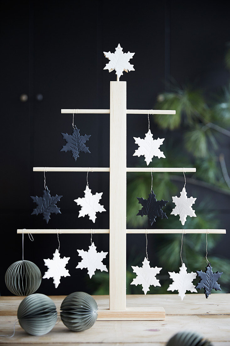 Stylised Christmas tree decorated with snowflakes and paper honeycomb baubles