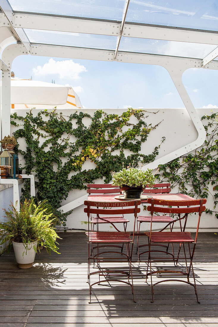 Red Folding Table And Chairs On Roof Buy Image 13176891 Living4media