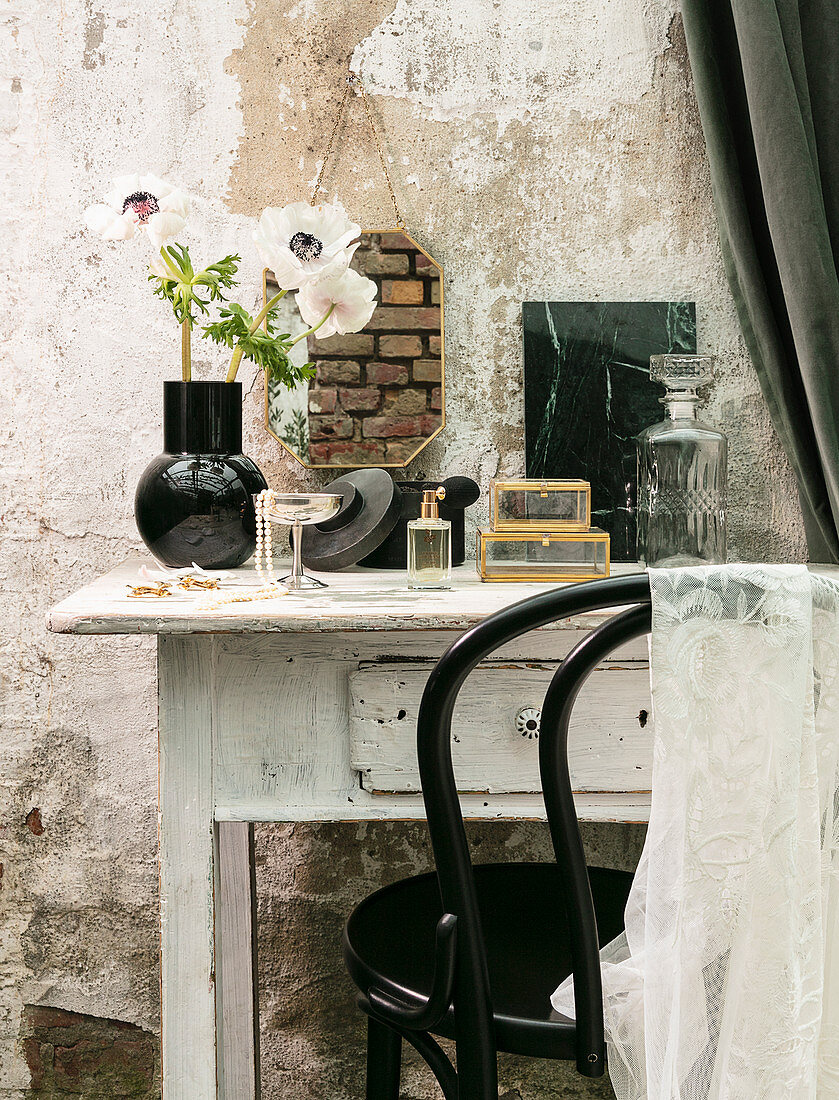 Vintage-style accessories n on shabby-chic dressing table