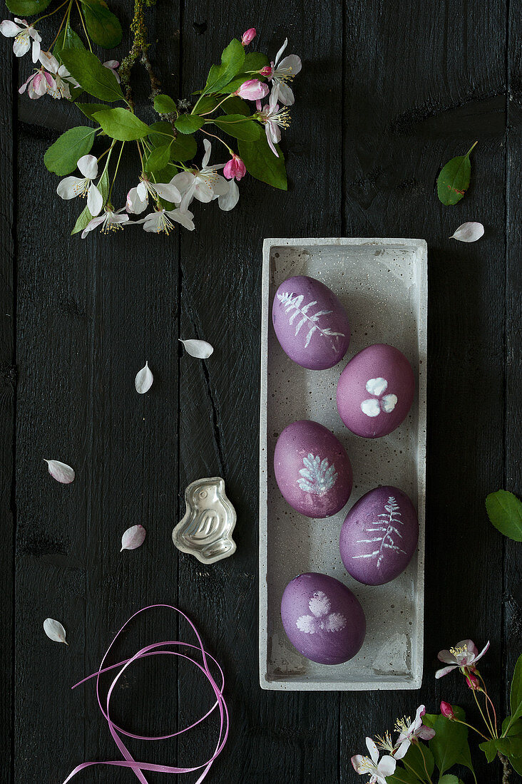 Dyed purple Easter eggs with botanical motifs