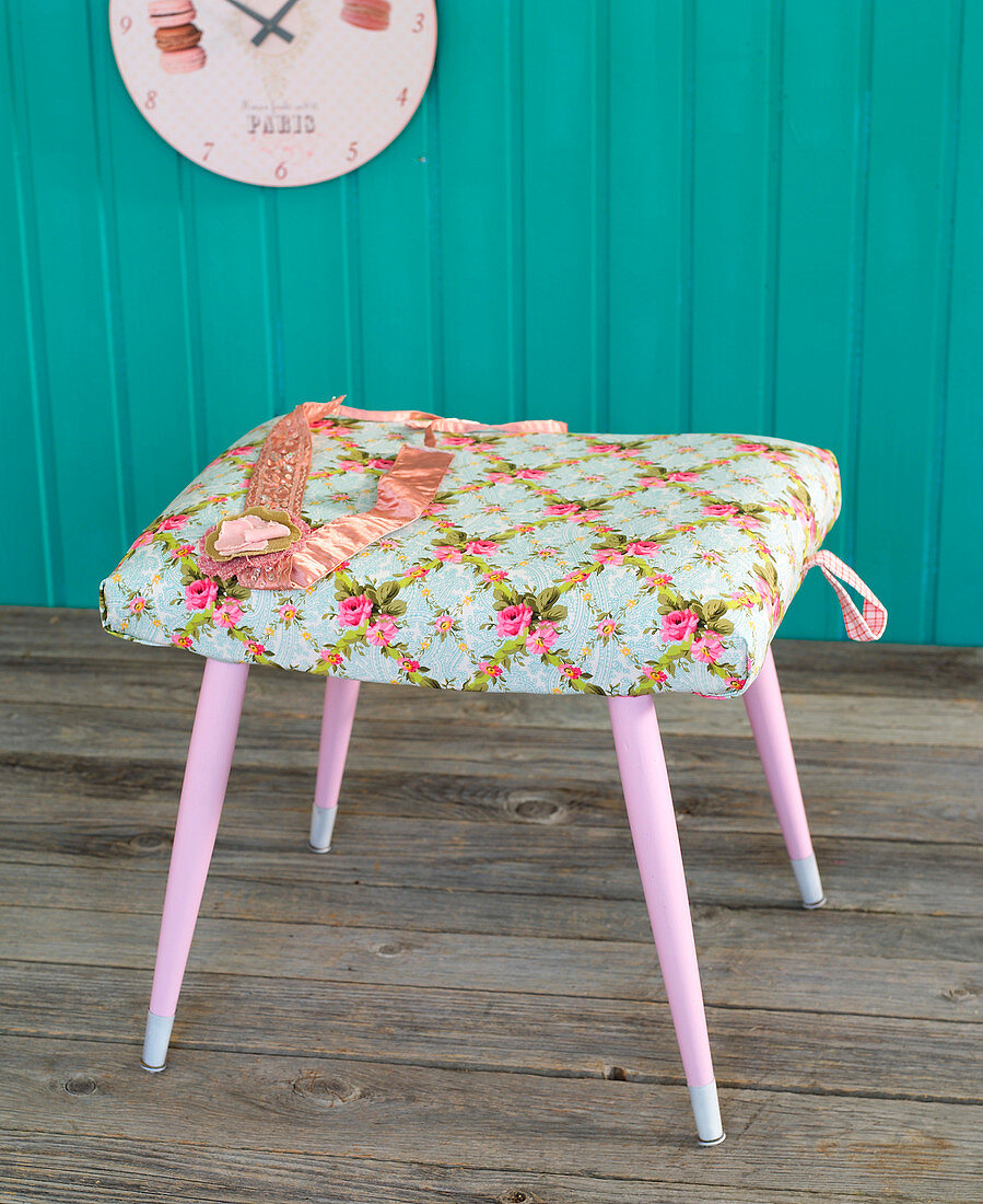 Stool with seat covered in floral fabric