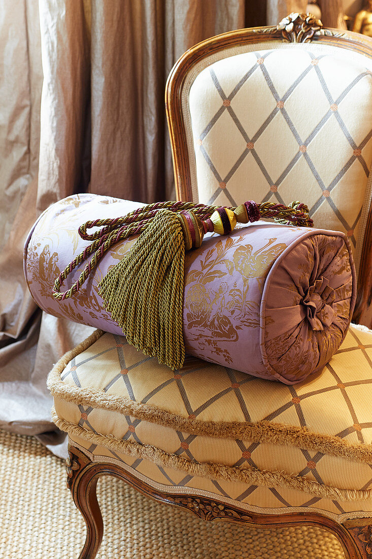 Tassel and bolster on Baroque chair with diamond-patterned upholstery