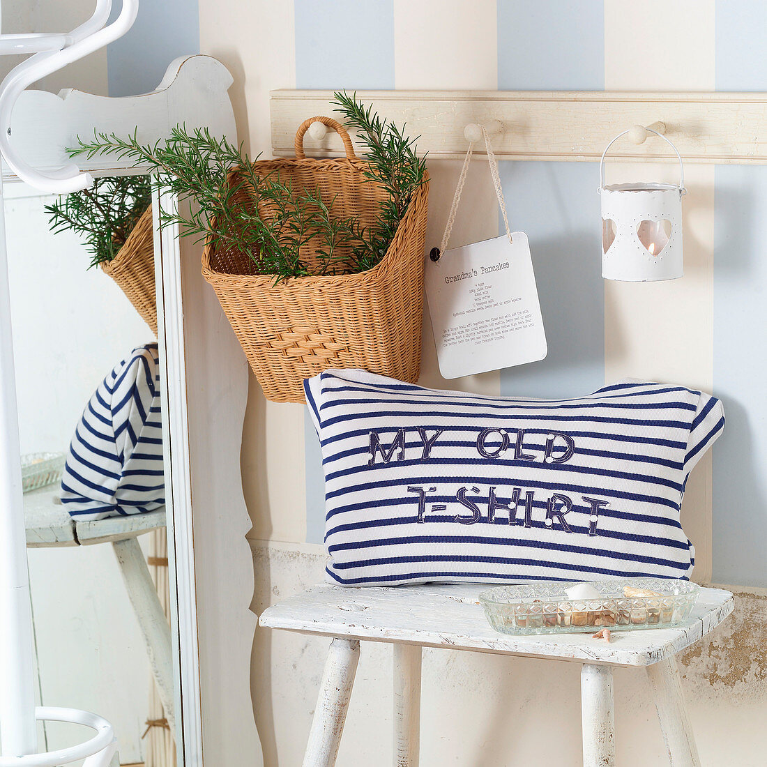 Maritime cushions with lettering made from old, blue-and-white striped T-shirt