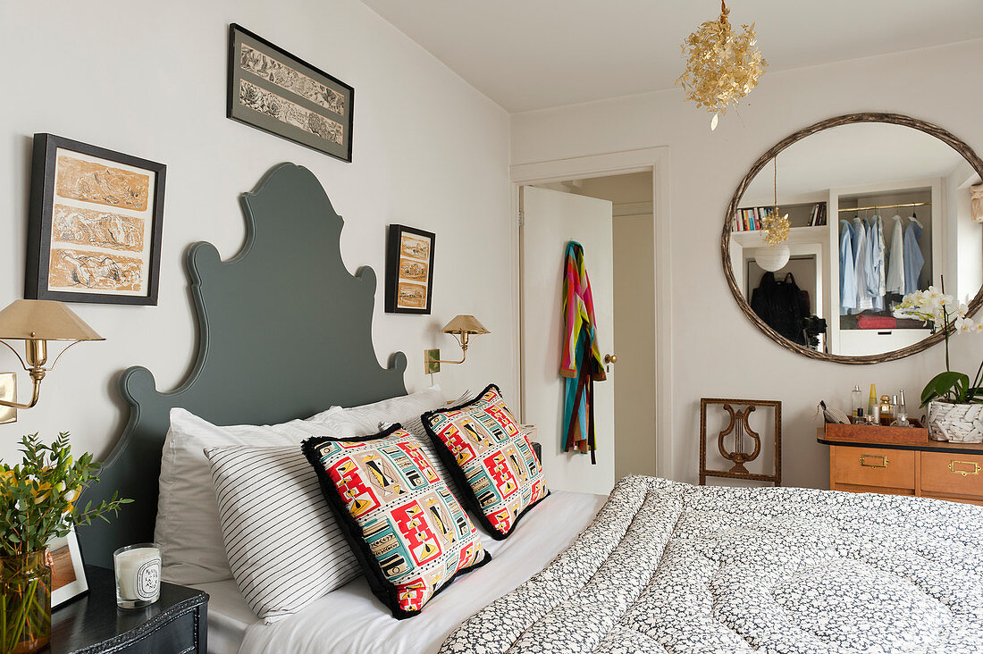 Bed with curved grey headboard in classic bedroom