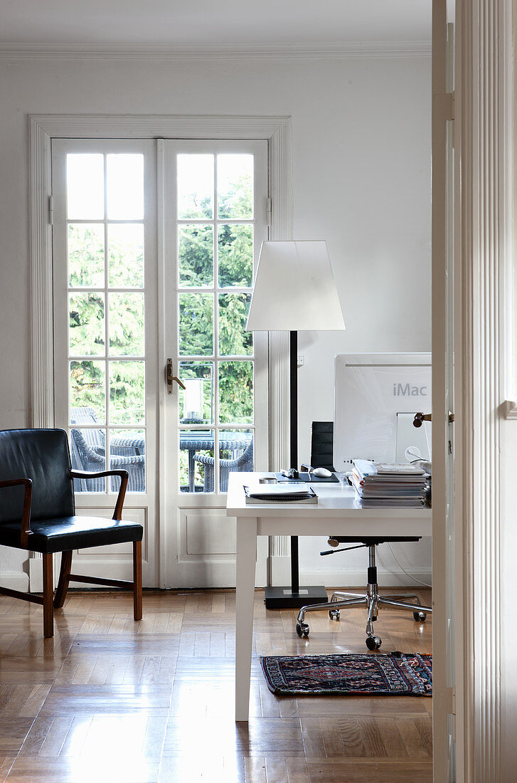 Classic study with lattice French windows leading onto balcony