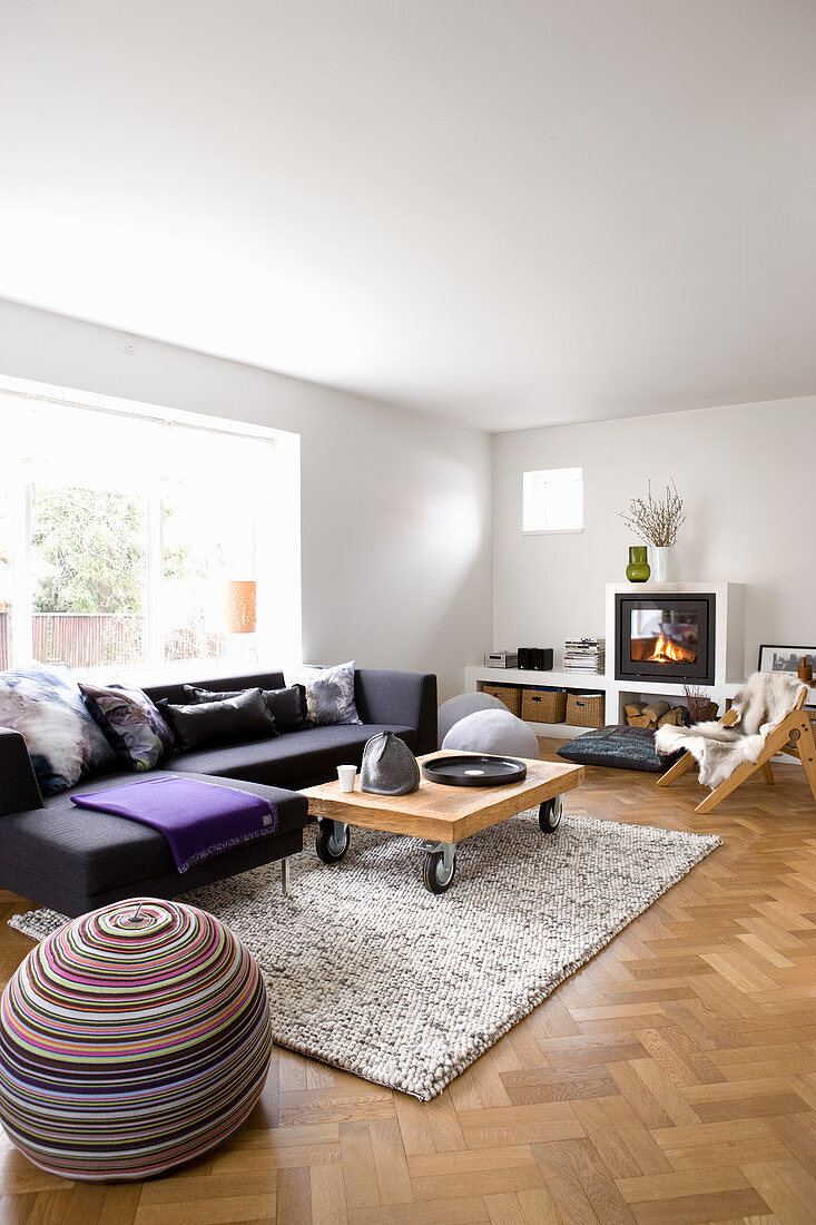 Corner sofa and coffee table on castors in pleasant living room