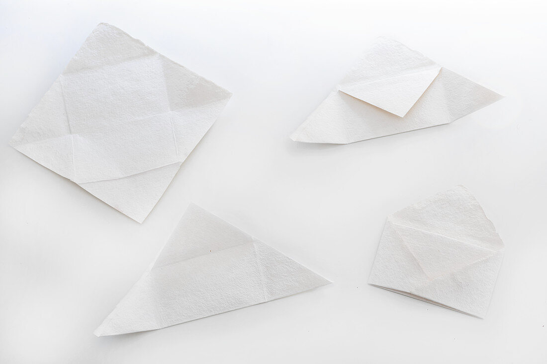 Folding paper into and envelope