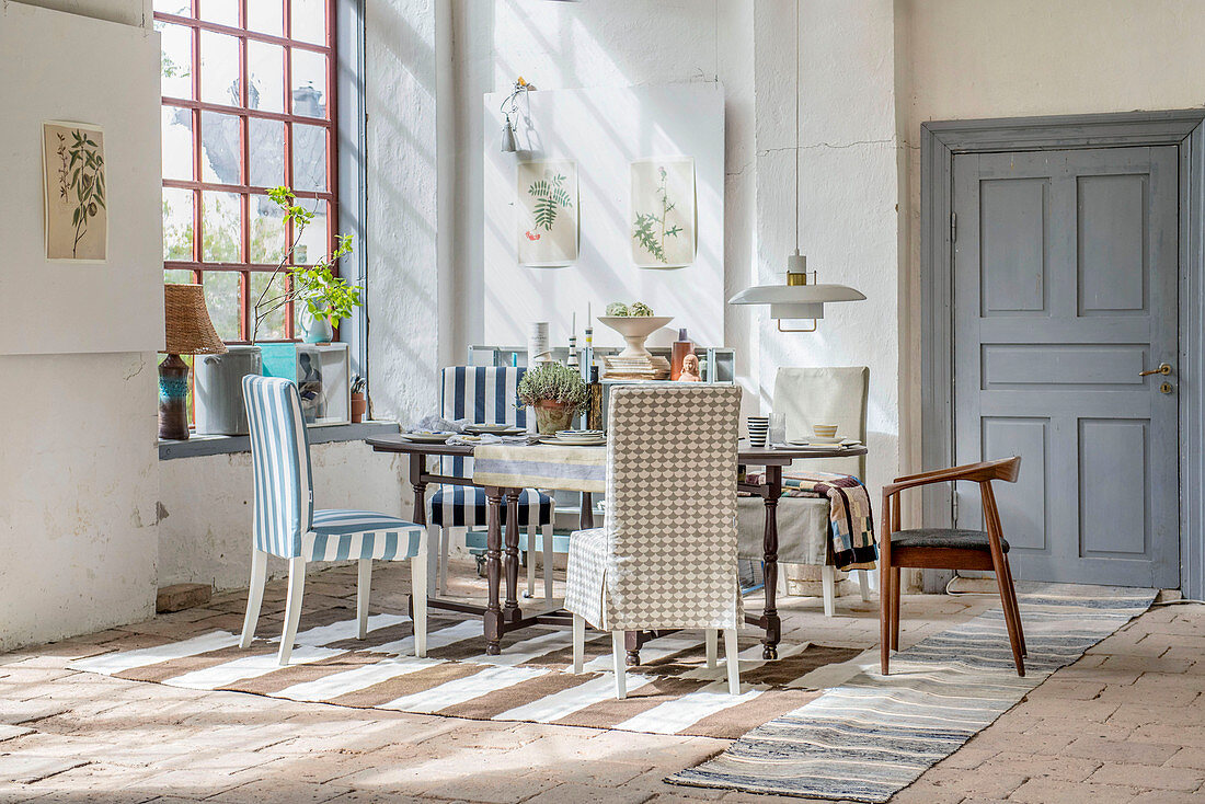 Various chairs around table in Mediterranean dining room