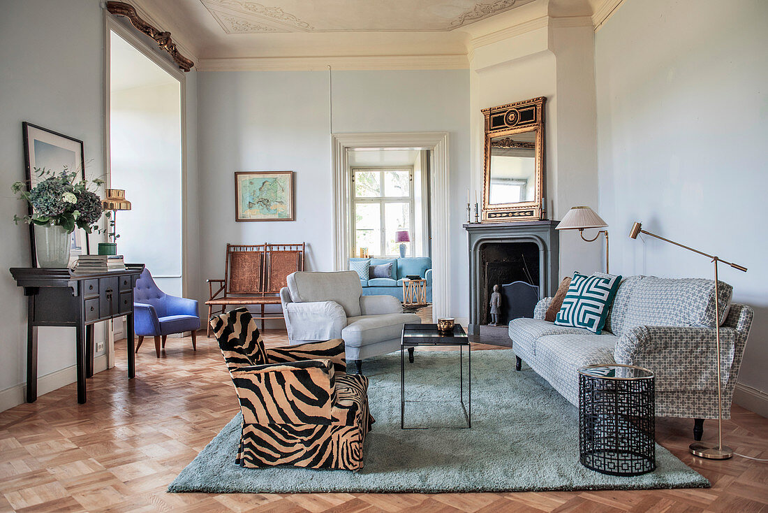 Open fireplace and parquet floor in classic living room with eclectic style