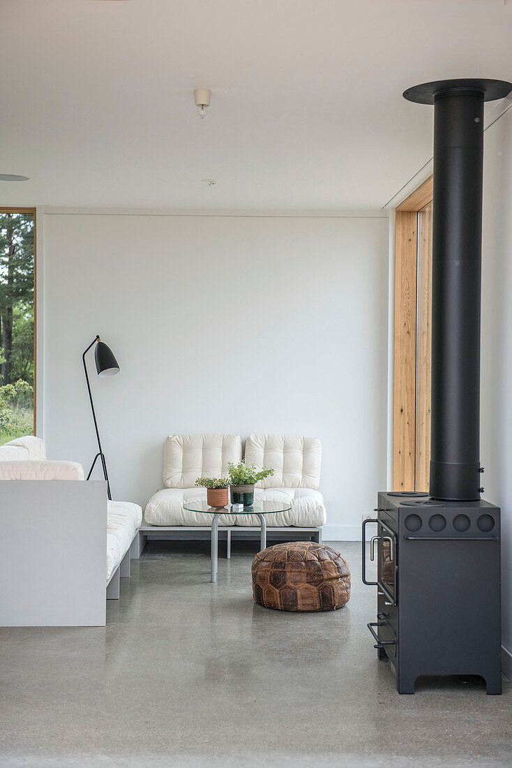 Wood-burning stove in simple living room in neutral shades