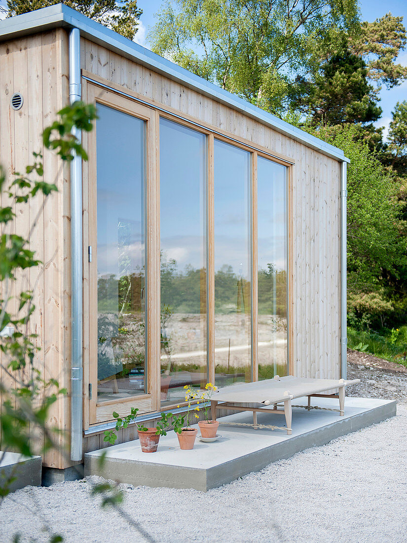 Wooden house with glass wall