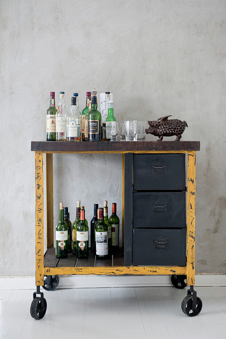 Rustic, Industrial-style serving trolley used as minibar