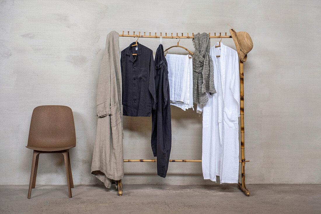 Bamboo cloths rail next to chair