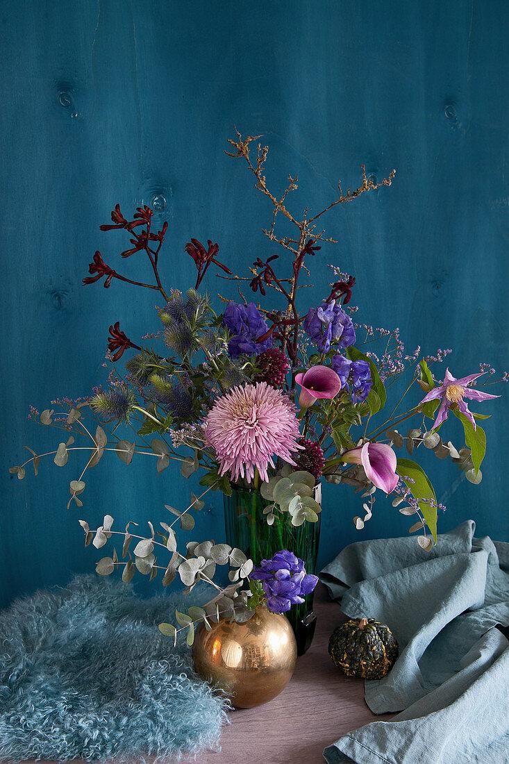 Autumn arrangement of chrysanthemums, calla lilies, gerbera daisies, monkshood, eucalyptus, clematis, kangaroo paw and sea lavender