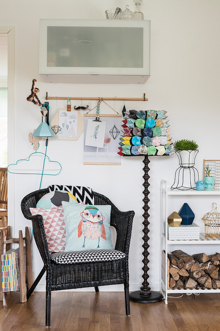 Black wicker chair and standard lamp with DIY lampshade