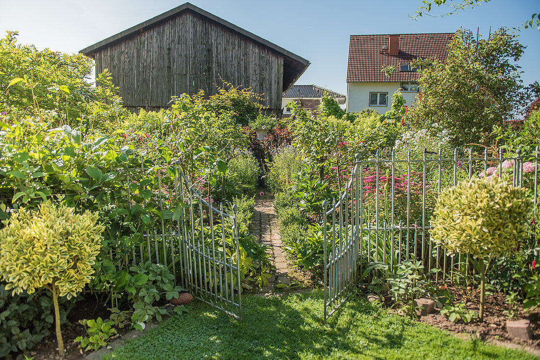 Open garden gate to the cottage garden