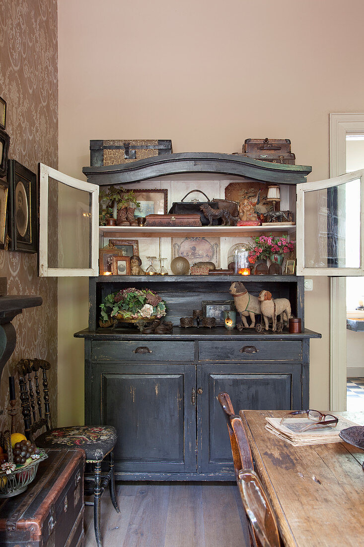 Eclectic collection on old dresser