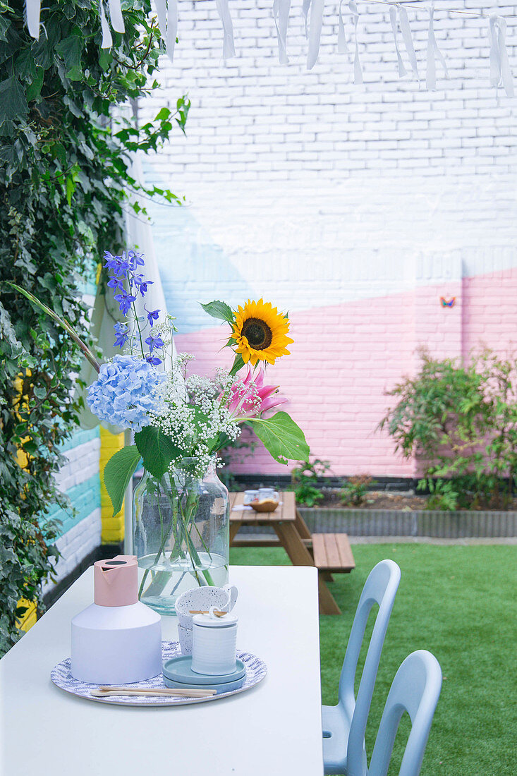 Brightly painted brick wall of courtyard garden