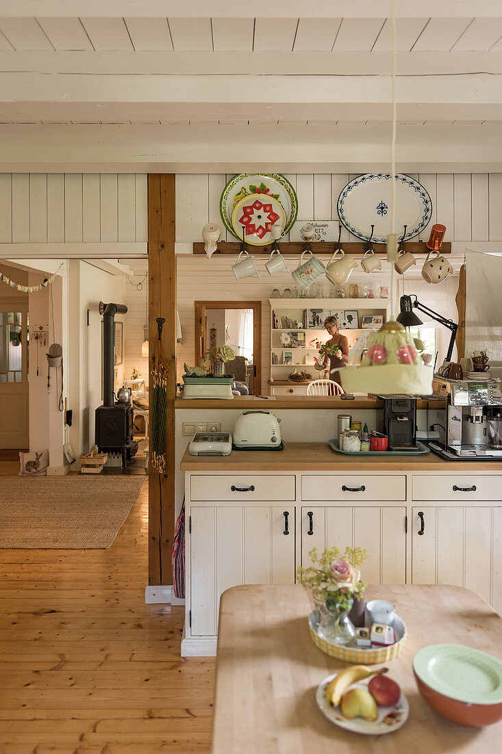 Country-house-style kitchen in cosy, open-plan interior