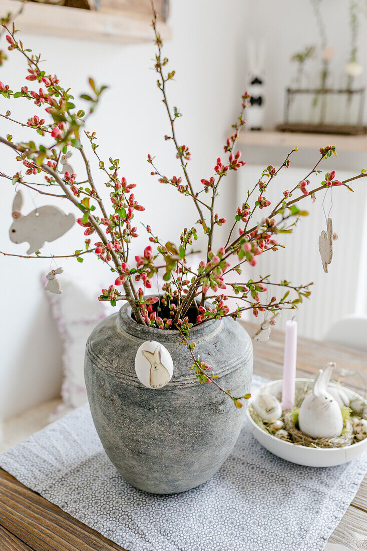 Bouquet of flowering quince with Easter decorations
