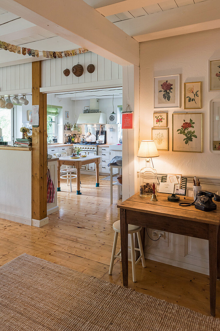 View from pleasant hall into open-plan, country-house-style kitchen