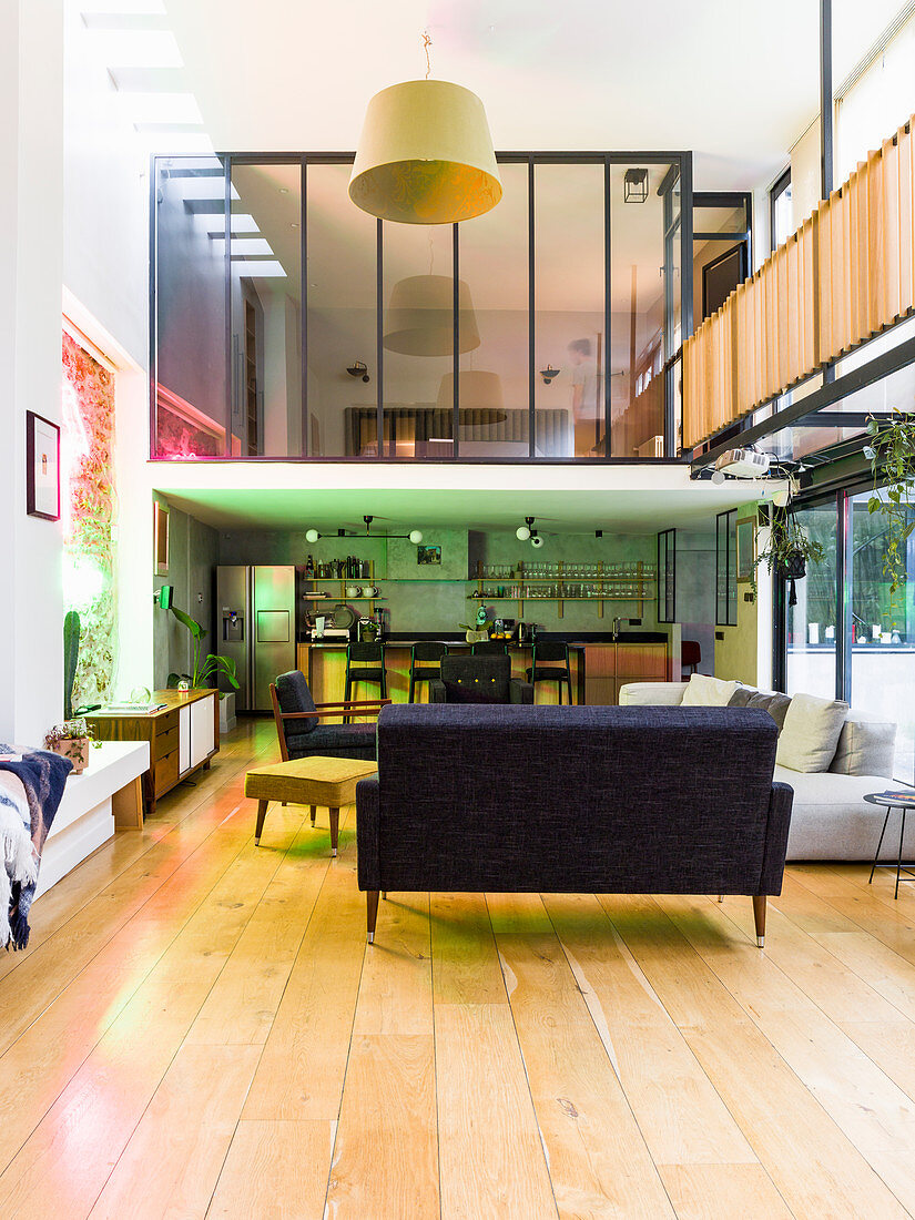 Open-plan interior with glazed gallery