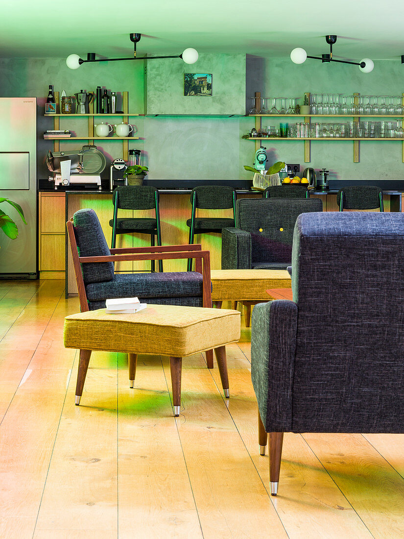 Upholstered seating in living area in front of bar